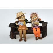 couple on wooden chair